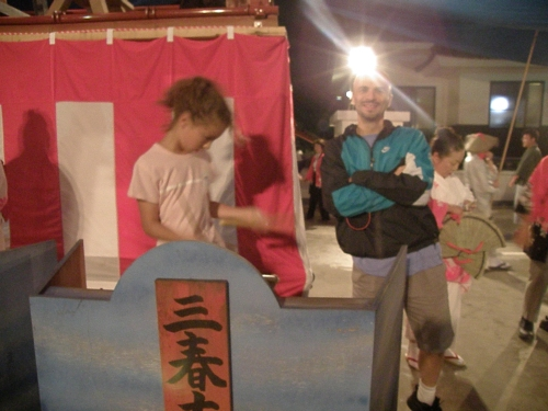 My friend and his daughter at Obon festival. She's playing the drums!