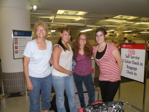 At the airport check in, right before I left. We were all trying to smile while we were crying...