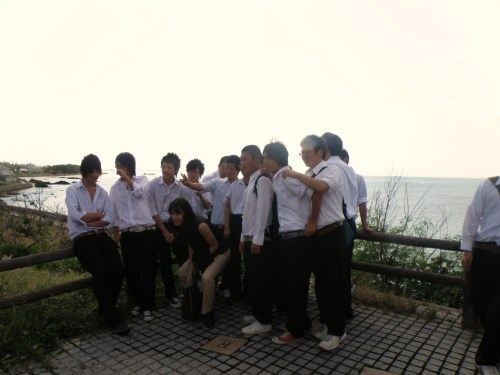 My homeroom teacher, in the middle of a group of boys at the lighthouse.