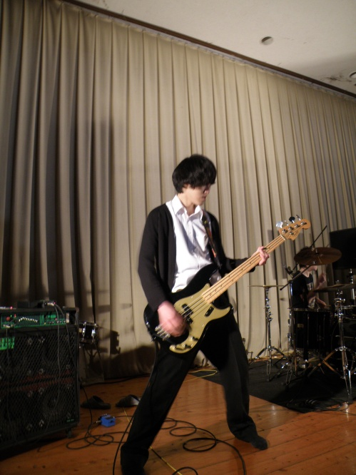 Bassist in my friend's band. They're rockstars!