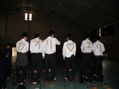 These guys put tape on their shirts to spell out girls names, while the girls were onstage dancing. How cute!
